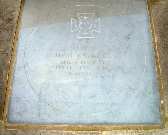 The flagstone set into the foot of East Grinstead's war memorial honouring Godley's bravery and his commitment to his duty and to his comrades.
