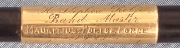 Part of the dedication inscribed on a gold band on the baton.