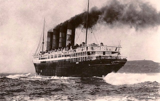 RMS Lusitania under full steam in her pre-war livery.