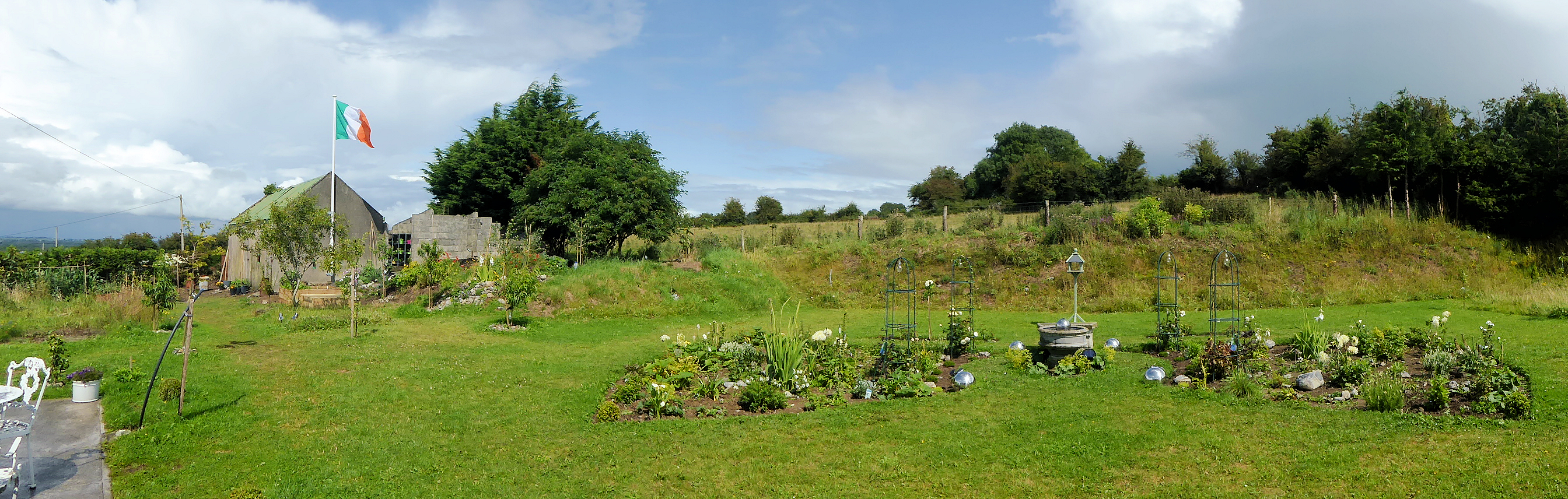 Panoramic view of the back quarter acre.